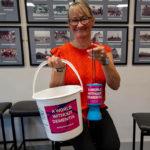 lady holding donation bucket