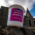 Donation bucket for the memory walk on wall with Church behind