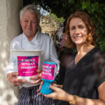 Couple holding donations bucket at The Black Horse